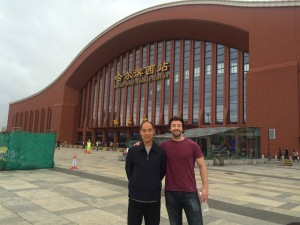 Me and my Father-in-law in front of the Harbin Train Station. Just, you, standing around.